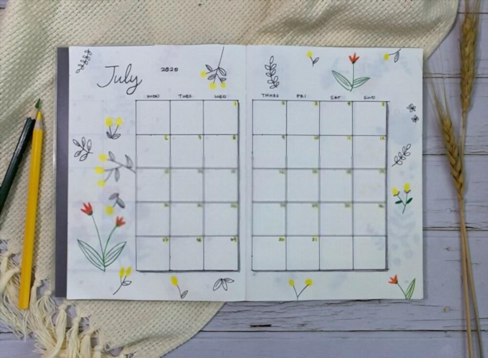 Log mensal de julho com calendário do mês e desenho de flores ao redor.