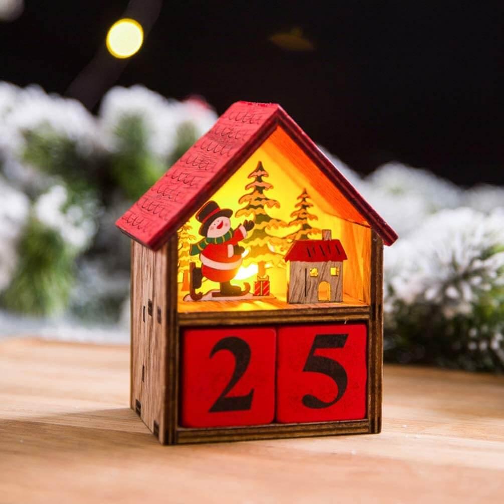 Calendário de contagem para o Natal em formato de casinha.